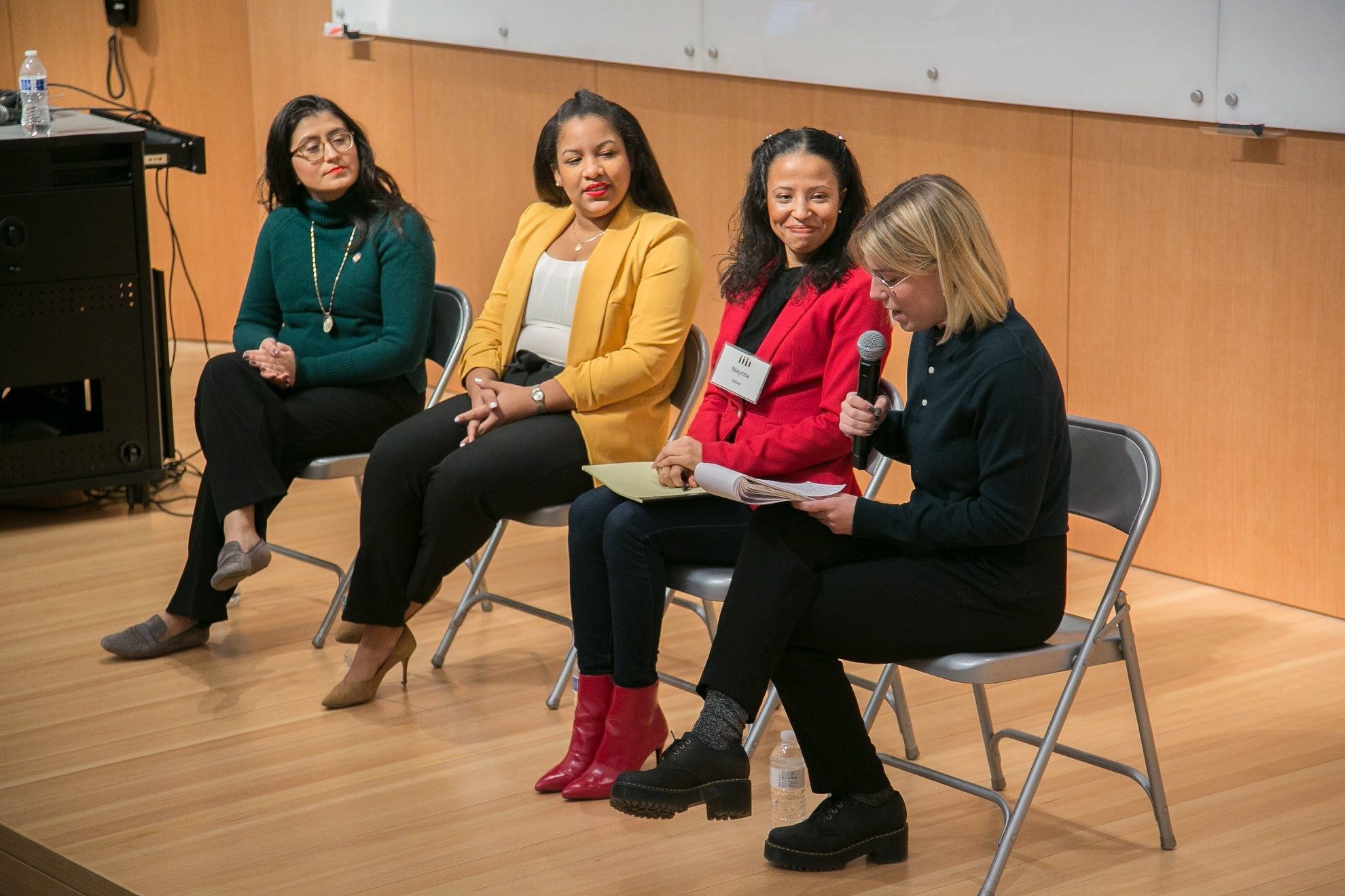 Nayma Silver-Matos speaking at IGNITE's Young Women Run conference in Brooklyn, New York